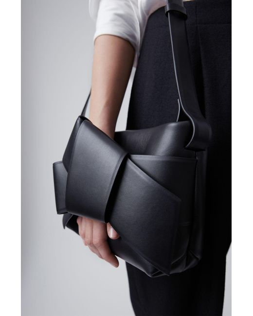 FIG 1 _ Musubi handbag black $950 Acne Studios Musubi Handbag black is a functional bag based on the knot in a traditional Japanese obi sash.